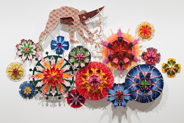 Brian Robinson …and meanwhile back on earth the blooms continue to flourish 2013 wood, plastic, steel, synthetic polymer paint, feathers, plant fibre and shell - 200.0 x 350.0 x 50.0cm Artwork courtesy of the artist and Mossenson Galleries © the artist, courtesy of Mossenson Galleries