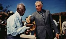 Mervyn Bishop, Prime Minister Gough Whitlam pours soil into the hands of traditional land owner Vincent Lingiari, NT, 1975 Colour Lambda print, 120 x 120 cm (framed) © Courtesy the artist and Josef Lebovic Gallery, Sydney