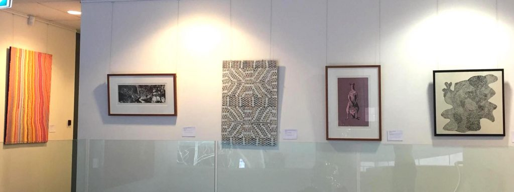 "View of exhibition ""Scratching the surface"" at Alliance Francaise Sydney - Artworks by Mary Anne Nampijinpa Michaels, Nici Cumpston, Djirrirra Wunuŋmurra, Reko Rennie, Tommy May Ngarralja - Photo IDAIA"