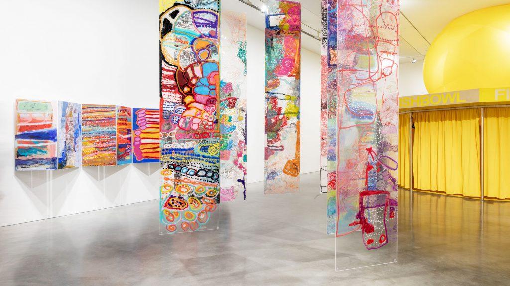 Installation view at MCA featuring artworks by Daisy Jupulija, Sonia Kurarra, Tjigila Nada Rawlins and Ms Uhl, alongside Eugenia Lim's 'The Australian Ugliness' (right) - Photo Jacquie Manning