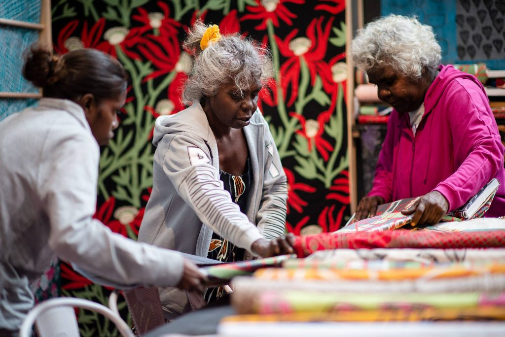 Artists Susan, Jacinta and Janet at the Babbarra Women's Centre stall for TARNANTHI 2018. Photo: Nat Rogers.