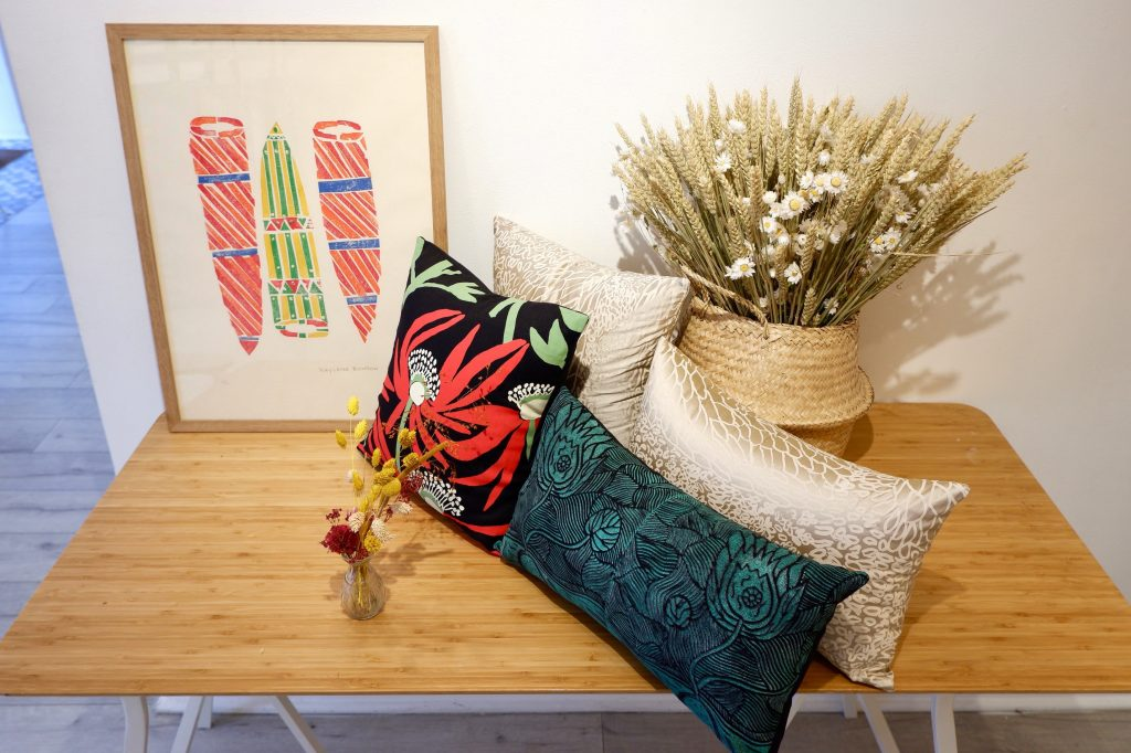 View of Babbarra Women artworks and textile collaboration pieces - Photo IDAIA