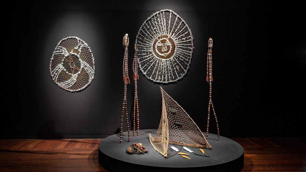Installation view - Tarnanthi 2020 Open Hands featuring Karrh (Spider) and Ngalbenbe (sun story) by Lena Yarinkura, Art Gallery of South Australia, Adelaide, © Lena Yarinkura, Maningrida Arts and Culture, Copyright Agency; photo Saul Steed